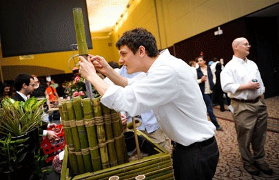 Kathan Bender tinkers with a bamboo water fountain created by his team for Freshman Engineering Design Day.